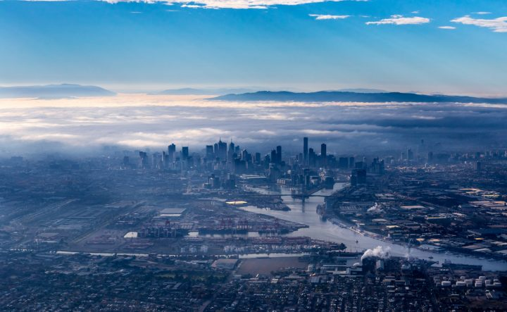 A birds-eye view of the Melbourne CBD, with cloudy fog overhead