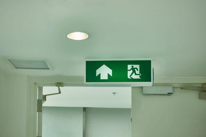 An illuminated exit lighting sign that meets Australian standards