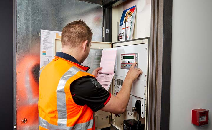 A Fire & Wire service technician providing fire safety maintenance